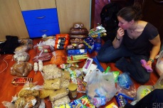 Bishkek, Kyrgyzstan. Sev goes over the different food items and starts organising everything into meals.