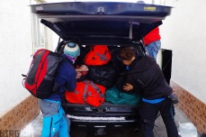 Karakol, Kyrgyzstan. Arnaud and Sev load up the 4x4 and try and get everything in.