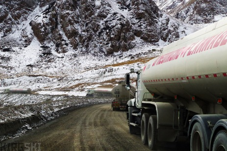 Barskoon Pass, Kyrgyzstan. A steady stream of huge tankers drive up the pass, taking their liquid to the gold mine.