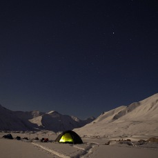 Our camp is lit up by the moon, which bathes everything in a cold glow.