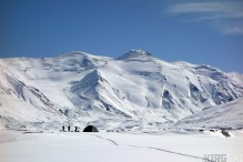 Nico, Sev and Arnaud just getting back from a day's skiing. Our tent is dwarfed by theice giants all around.