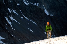 Jordi climbs up onto the glacier, lit up by the falling sun.