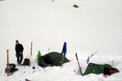 Camp at the base of the col, under the storm.