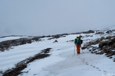 Hiking up the first tongues of snow