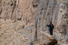 The rocky wall, Reza in the foreground
