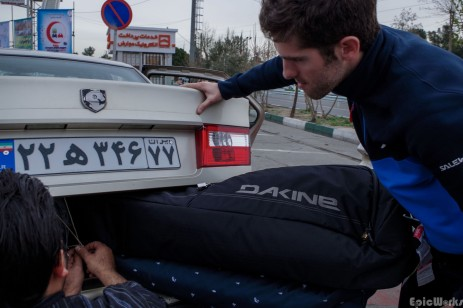 The art of fitting skis into a car that is clearly too small