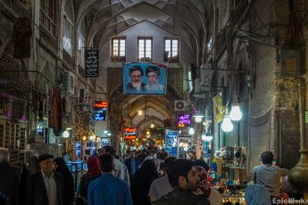 The bazaar, overlookep by the omnipresent Supreme Leader and President: