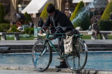 A guy washes his bike next the fountains. For some reason all bikes in Iran seem to be green: With tape: