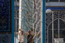 Two mean chatting outside the congregational Mosque