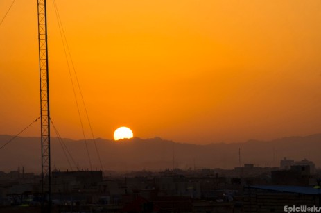 The sun rises above the little city on the edge of the desert