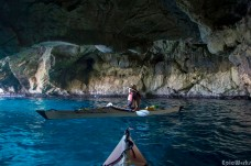 Discovering one of the caves hidden at the foot of the cliffs
