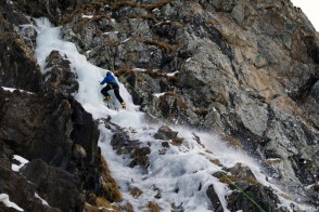 The brittle ice brakes upon impact, tinkling down the rocky slope 2016