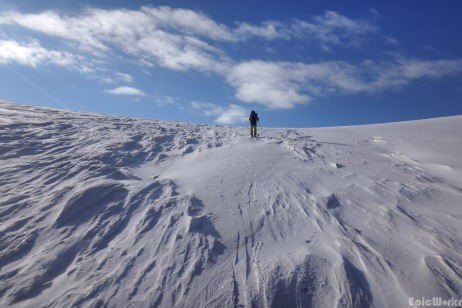 Arriving at the pass, the brutal winds have made sustrugi like snow formations (courtesy JB Cazaux)
