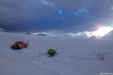 Our camp, myself checking the snow as it melts on the cooker (courtesy JB Cazaux)