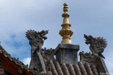 The dragon decorations above the temple