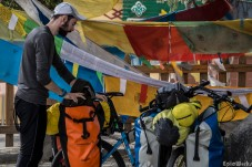 Stopping beneath the prayer flags