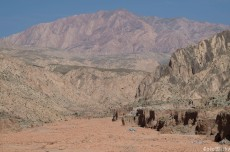 The arid mountains above us