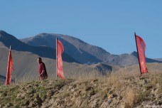 A monk looks down at our passing.