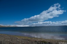 Once the clouds have dispersed the colours of Ngoring lake contrast with the snow