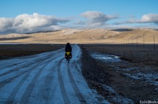 We head out, along the frozen road