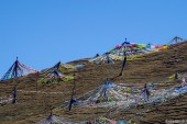 Prayer flags on the mountain above the temple