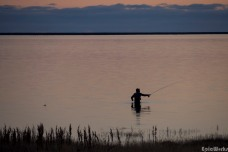 The lone fisherman, also enjoys the last rays to swing his rod forwards